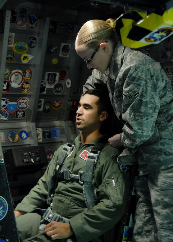 Airman Breanne Blain checks Maj. Raja Chari's G-Suit and straps him into the cockpit before beginning the human centrifuge, Jan. 14, at Holloman Air Force Base, N.M. Major Chari is assigned to the 40th Flight Test Squadron, 46th Test Wing, Air Force Material Command. He was the 30,000 student to go through the course. (U.S. Air Force photo/ Senior Airman Anthony Nelson)