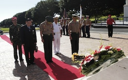 The commandant of the Republic of Korea Marine Corps, Lt. Gen. Lee Hong Hee (front, center), and an official party bow their heads in tribute to fallen service members who fought for his country more than 50 years ago.
