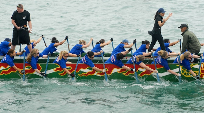 The Kadena Air Base Women's team pulls ahead of the competition during the Dragon Boat Race May 5, 2008 at Tomari Port in Naha City, Okinawa, Japan. The race is an annual tradition held every May on Okinawa. (U.S. Air Force photo/Airman Chad Warren)(Released)