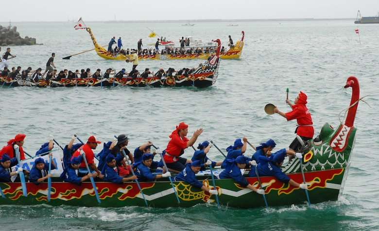 Three teams battle for the lead during the Dragon Boat Race May 5, 2008 at Tomari Port. The race, which caps off the week-long series of Japanese holidays called Golden Week, has been held annually for centuries on Okinawa.
