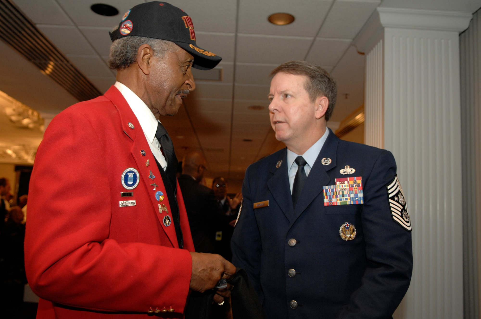 Tuskegee Airman Ezra Hill speaks with Chief Master Sergeant of the Air Force Rodney McKinley Jan. 20 at the Bolling Club on Bolling Air Force Base, D.C. More than 180 Tuskegee Airmen and their families gathered for a special breakfast before being bused downtown for the 2009 inaugural events.  (U.S. Air Force photo by Senior Airman Tim Chacon)