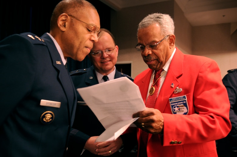 Maj. Gen. Larry Spencer (left), director of the Air Force Budget, and Maj. Gen. Bruce Green, deputy surgeon general, speak with Donald E. Elder, an original Tuskegee Airman Jan. 20 at the Bolling Club on Bolling Air Force Base, D.C. More than 180 Tuskegee Airmen and their families gathered for a special breakfast before being bused downtown for the 2009 inaugural events. (U.S. Air Force photo/Staff Sgt. Dan DeCook)
