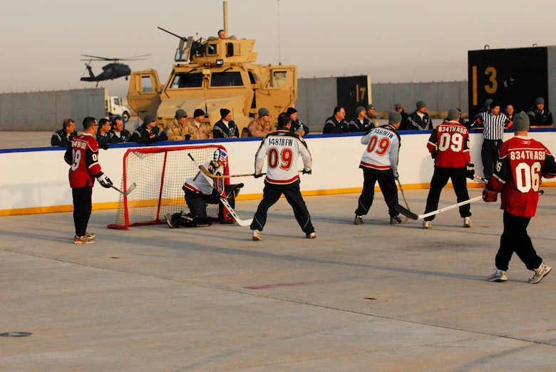 "Minnesota National Guardsmen compete in the Jan. 17 Minnesota Hockey Day in Iraq game between the Soldiers of the 834 Aviation Support Battalion ""Skaters? and the Airmen of the 148 Fighter Wing ""Bulldogs.?  Gameplay was punctuated by coalition aircraft who shared the flight line with the hockey rink. The game was held in conjunction with Fox Sports Net North's Minnesota Hockey Day coverage. The 834 ASB and the 148 FW are Minnesota National Guard units currently deployed to Joint Base Balad, Iraq in support of Operation Iraqi Freedom."