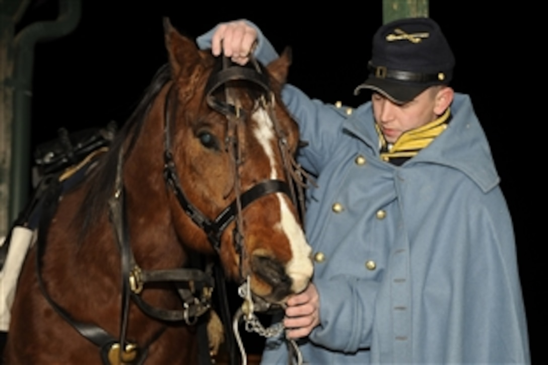 A U.S. Army soldier assigned to the 1st Infantry Division Commanding General's Mounted Color Guard, Fort Riley, Kan., prepares his horse to participate in the 56th Presidential Inauguration in Washington, D.C., Jan. 20, 2009. More than 5,000 men and women in uniform are providing military ceremonial support to the presidential inauguration, a tradition dating back to George Washington's 1789 inauguration.