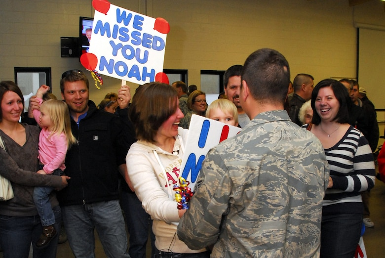 Family members welcome home U.S. Air Force Senior Airman Noah Feehan, 148th Fighter Wing, in Duluth, Minn. January 20, 2009.  Approxematly 60 Air National Guardsmen returned home from their recent Air Expeditionary Force deployment to Joint Base Balad, Iraq.