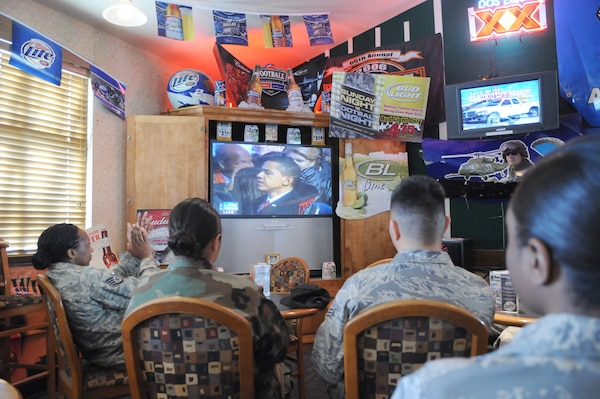 Team Randolph Airmen watch as Barack Obama is sworn in as the 44th president of the United States during the 2009 Inauguration Mixer at the enlisted club Jan. 20. (Photo by Rich McFadden)