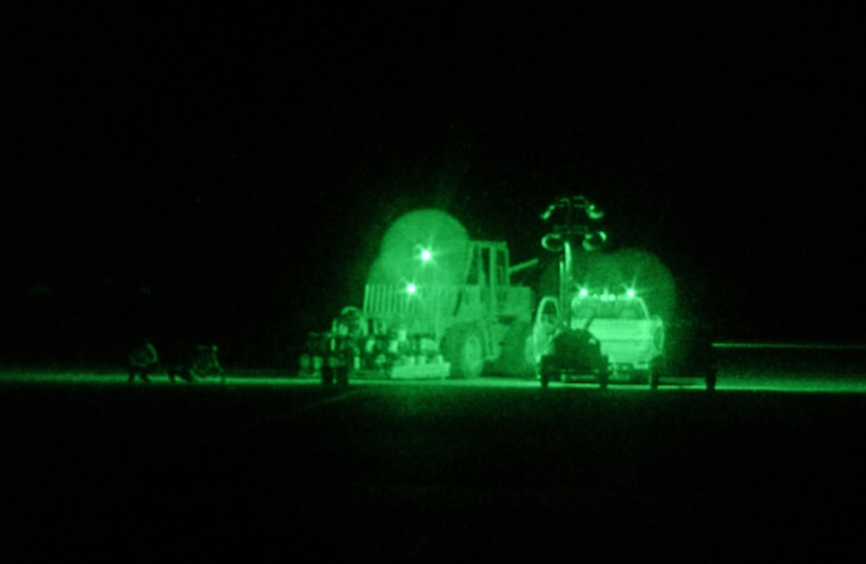 Air Force personnel with the 1st Expeditionary RED HORSE Group (ERHG) take advantage of the cool night air to repair sections of the runway at Tallil AB, Iraq, in support of Operation Iraqi Freedom. (U.S. Air Force photo)