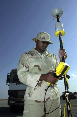 Senior Airman Pratt Vivekanandan, an engineering journeyman with the 819th/219th Expeditionary RED HORSE Squadrons (ERHS), uses a global positioning system (GPS) rover and data collector to check the elevation during a runway construction project in support of Operation Enduring Freedom. (U.S. Air Force photo)