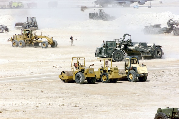 The 823rd RED HORSE Squadron (RHS) levels out an area and construct a new aircraft parking ramp support of Operation Enduring Freedom. (U.S. Air Force photo)