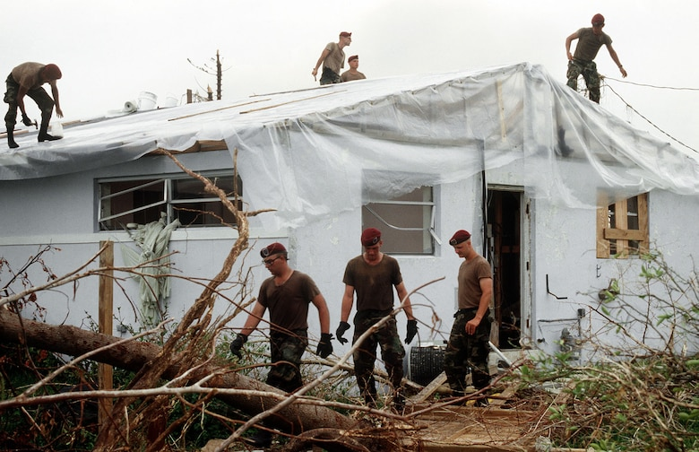 Members of the 202nd RED HORSE Civil Engineering Squadron repair the roof on a foster child care facility in the aftermath of Hurricane Andrew in 1992. (U.S. Air Force photo)