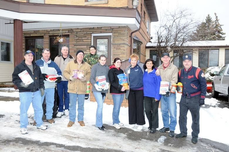 107th members stand in front of Community Missions in Niagara Falls during a donation drop off on December 16.