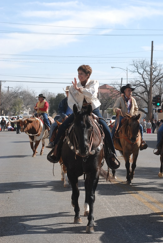 Colonel Merrily Madero, 17th Training Wing vice commander, rides a stallion, Lance, during the 2008 San Angelo Stock Show and Rodeo Parade. Colonel Madero will head to her next assignment at Randolph Air Force Base, Texas, in April. (U.S. Air Force photo by Staff Sgt. Angela Malek)