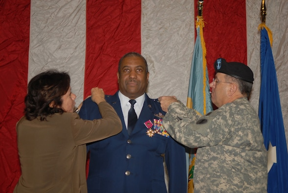Brig. Gen. Ernest Talbert, vice commander, Delaware Air National Guard, is pinned with a second star signifying the honorary rank of major general in the Delaware National Guard upon his retirement from the Delaware ANG in New Castle, Del. on Jan. 11, 2009. Gen. Talbert's wife Richelle and Delaware National Guard Adjutant General Maj. Gen. Francis Vavala perform the pinning on ceremony. Gen. Talbert, a rated command pilot with more than 6,500 flight hours, flew C-130 aircraft missions in Operation Desert Storm and was the 166th Airlift Wing commander in Operation Iraqi Freedom. During his 36-year career he became the first African-American colonel in the Delaware ANG, and the first and only African-American general in the over 350-year history of the Delaware National Guard. (U.S. Air Force photo/Staff Sgt. Melissa Chatham)