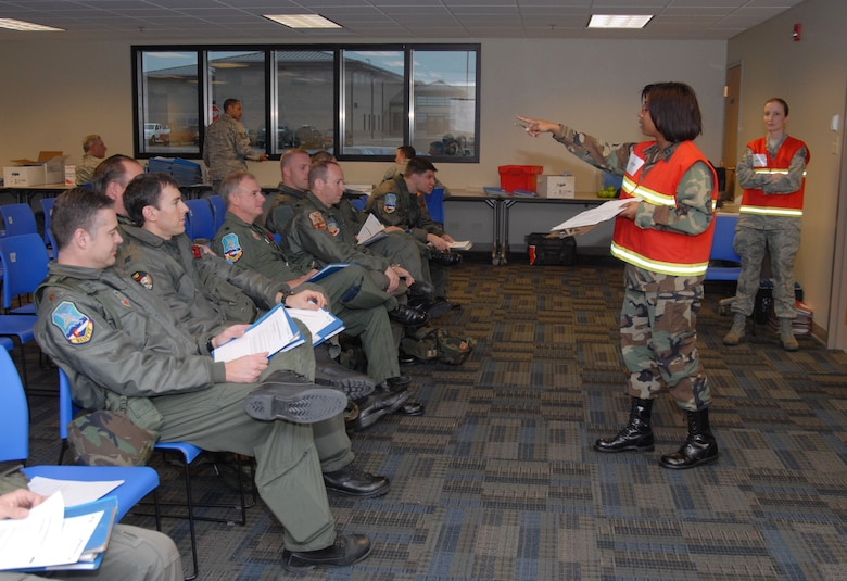 CaptainTabatha Johnson, from the 140th Wing's Military Equal Opportunity Office, conducts mobility training for the 120th Operations Group pilots during an Operational Readiness Exercise in preparation for an upcoming inspection.