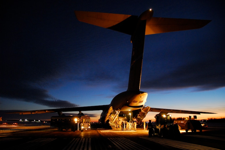 A U.S. Air Force C-5 Galaxy from Dover Air Force Base sits idle on a runway at Duluth Air National Guard Base, Minn. before it is unloaded January 20, 2009.  The aircraft transported members of the 148th Fighter Wing and equipment returning from a recent deployment to Joint Base Balad, Iraq as a part of the 148th's  Air Expeditionary Force (AEF) deployment. (U.S. Air Force photo by TSgt Jason W. Rolfe) (Released)