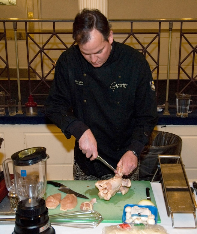 Gary Garner concentrates as he works on his dish that took first place in the Maxwell-Gunter Officers' Spouses' Club Iron Chef competition. (Air Force photo by Jamie Pitcher)