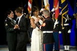 President Barack Obama  dances with U.S. Army Sgt. Margaret H. Herrera while first lady Michelle Obama dances with U.S. Marine Corps Sgt. Elidio Guillen at the Commander in Chief's Ball at the National Building Museum, Washington, D.C., Jan. 20, 2009. The ball honored America's servicemembers, families, the fallen and wounded warriors.