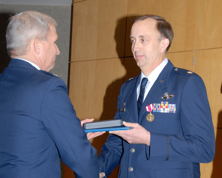 Lt. Col. Jim Treutel (right), outgoing commander of the 109th Airlift Squadron, is congratulated after receiving the Meritorious Service Medal from Col. Bob Cayton, 133rd Operations Group Commander. Lt. Col Treutel is moving to the Minnesota National Guard Joint Force Headquarters Deputy J-3 position after relinquishing command of the 109th Airlift Squadron on January 25, 2009 at the St. Paul Air National Guard base. (USAF photo by Tech. Sgt. John Wiggins)