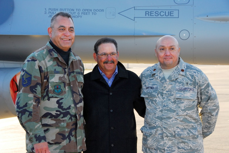 Master Sgt. Bert Otero and Chaplain (Maj.) Mike Martinez take a photograph with University of Arizona Softball Coach Mike Candrea. Coach Candrea was the U.S. Olympic Softball coach in 2004 and 2008, and he led teams to eight NCAA championships during his coaching career. (Air National Guard photo by Master Sgt. Dave Neve)