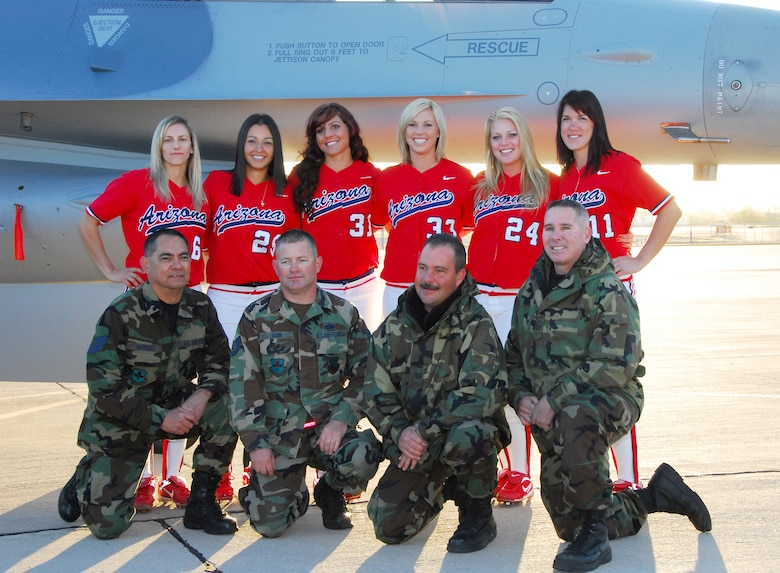 (From left to right) Tech. Sgt. Dave Marquez, Tech. Sgt. Rick Bain, Tech. Sgt. Jeff Maeser and Master Sgt. Jay Good take a souvenir photograph with members of the UofA Softball team in front of an F-16 on the flightline here Jan. 27. The Aircraft maintainers coordinated with UofA photographers to position the aircraft at the right angle for the sunrise photo shoot. (Air National Guard photo by Master Sgt. Dave Neve)