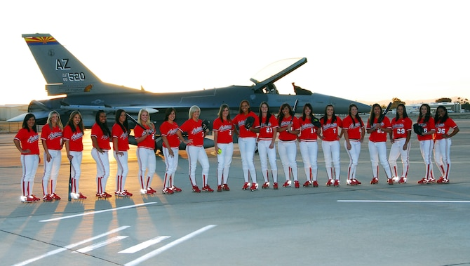 The University of Arizona Softball Team visited the 162nd Fighter Wing of the Arizona Air National Guard Jan. 27 to take photographs for the team's 2009 season poster. All 19 athletes visited the flightline at Tucson International Airport for a sunrise portrait with an F-16 Fighting Falcon. According to University officials, the posters will be printed by March and will be available free of charge at the Athletic Department offices at McKale Memorial Center. (Air National Guard photo by Master Sgt. Dave Neve)