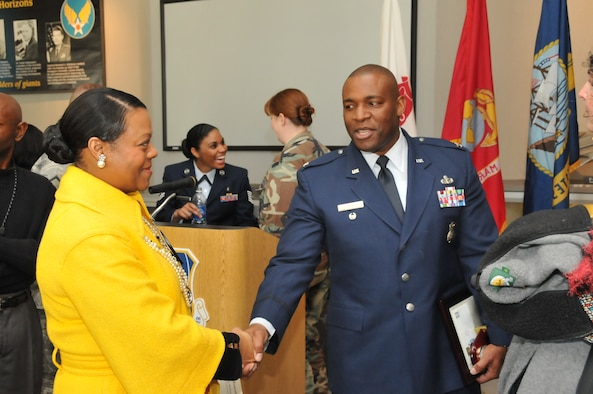 Tina Bonner, an Aerospace Testing Alliance (ATA) Human Resources benefits and employee recognition specialist, meets Col. Gerald Curry, Headquarters Air Force Space Command Security Forces director, after the colonel gave a presentation for AEDC's annual Martin Luther King Day observance event. ATA is the support contractor at AEDC. (Photo by David Housch)
