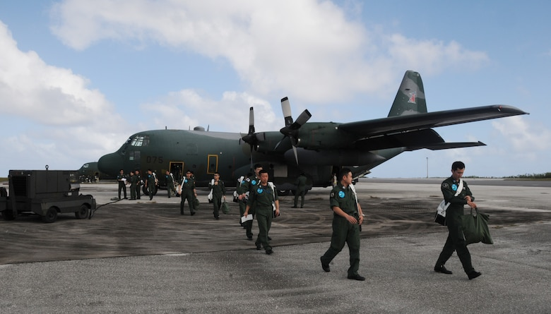 ANDERSEN AIR FORCE BASE, Guam -- Members of the Japan Air Self Defense Force offload after arriving here in a JASDF C-130 Hercules Jan 27.  More than 60 JASDF members arrived in three C-130s to participate in Exercise Cope North 09-1, a regularly scheduled exercise scheduled for Feb.2-13.  Cope North is designed to enhance U.S. and Japanese air operations in defense of Japan.  (U.S. Air Force photo by Senior Airman Ryan Whitney)