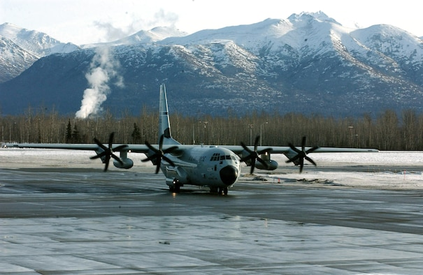 A WC-130J readies for takeoff at Elmendorf Air Force Base, Alaska. Reserve Hurricane Hunters of the 403rd Wing from Keesler AFB, Miss., deployed for a month to collect weather data ahead of pending winter storms. The data they collect increases the accuracy of the National Weather Service forecast by 10 to 20 percent. (U.S. Air Force photo/Tech. Sgt. James B. Pritchett)