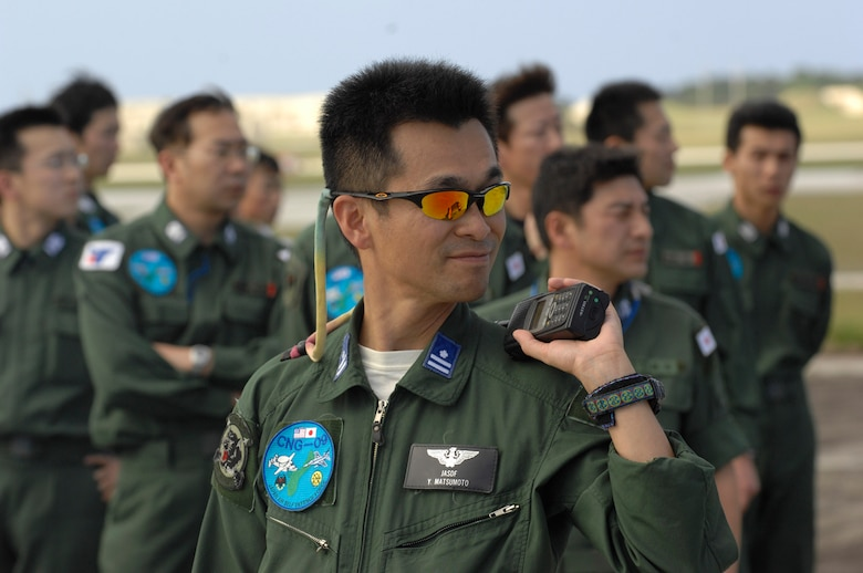 Japan Air Self Defense Force members wait outside of their C-130 after arriving Jan. 27 at Andersen Air Force Base, Guam. More than 60 JASDF members arrived in three C-130s to participate in Exercise Cope North 09-1, a regularly scheduled exercise scheduled for Feb. 2 through 13. Cope North is designed to enhance U.S. and Japanese air operations in defense of Japan. JASDF F-2s from Tsuiki Air Base, Japan, and E-2Cs from Misawa AB, Japan, will join forward deployed U.S. Air Force F-16 Fighting Falcons from Eielson Air Force Base, Alaska, B-52 Stratofortress' currently deployed to Andersen AFB, and Navy EA-6B from VAQ-136 Carrier Air Wing Five, Atsugi, Japan, will participate in this year's exercise with a focus on interoperability. (U.S. Air Force photo/Master Sgt. Kevin J. Gruenwald)