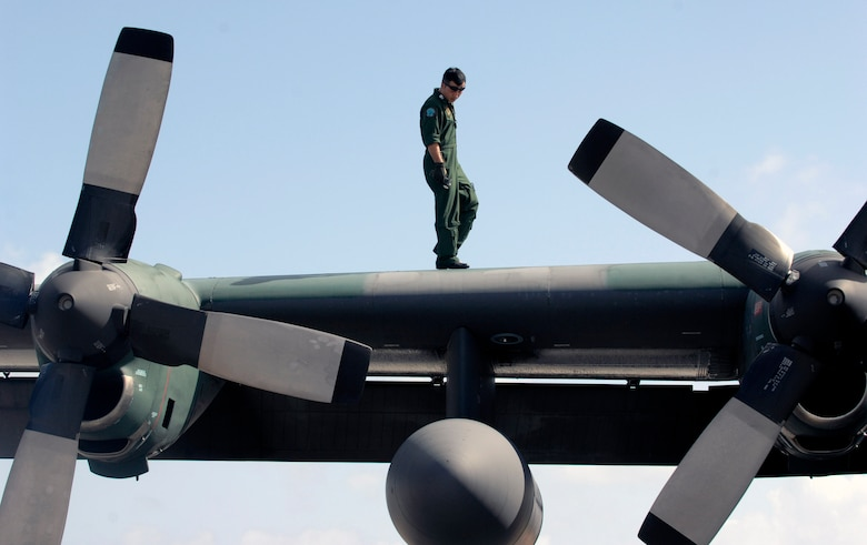A Japan Air Self Defense Force member performs post flight maintenance on a JASDF C-130 after its arrival for participation in Exercise Cope North 09-1 Jan. 27 at Andersen Air Force Base, Guam. More than 60 JASDF members arrived in three C-130s to participate in the regularly scheduled exercise scheduled for Feb. 2 through 13. Cope North is designed to enhance U.S. and Japanese air operations in defense of Japan. (U.S. Air Force photo/Master Sgt. Kevin J. Gruenwald)