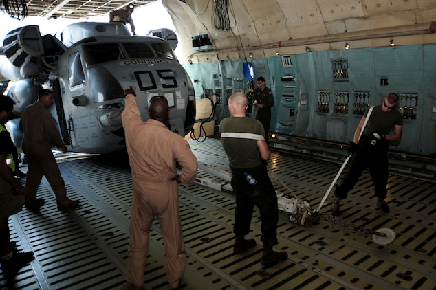 U.S. Marines load a CH-53 helicopter onto a U.S. Air Force C-5 Galaxy cargo plane at Camp Lemonier, Djibouti, Jan. 29, 2009. The helicopters were assigned to Combined Joint Task Force—Horn of Africa and were supporting Search and Rescue missions and Medical Civil Action Programs in the Horn of Africa.