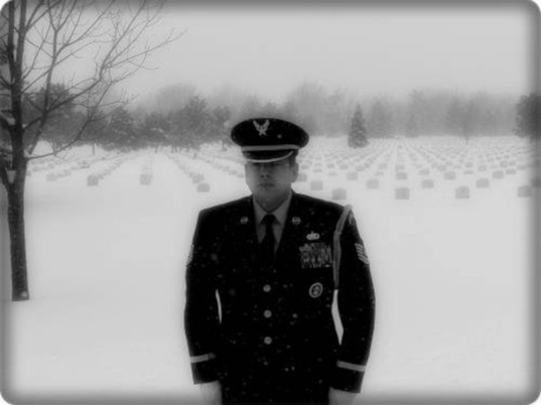 TEAM BUCKLEY WARRIOR OF THE WEEK -- Tech. Sgt. Edward Wise, Non-Commissioned Officer in Charge of the Mile High Honor Guard, stands at attention at Fort Logan National Cemetery during retiree military funeral honors. Sgt. Wise is Team Buckley's Warrior of the Week for Jan. 30 - Feb. 5. When he is not honoring our fallen Soldiers, Sailors, Airmen and Marines, Sgt. Wise enjoys spending free time with his family, camping, fishing and four-wheeling. (Courtesy photo)