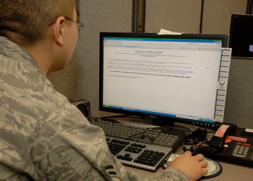 "SCOTT AIR FORCE BASE, Ill.-- A Scott computer user attempts to log onto a site that has been blocked through the base network. Sites are blocked to allow mission essential network performance is degraded by Airmen accessing  ""bandwidth-hogging"" sites. (U.S. Air Force photo/Tech. Sgt. Michelle Larche)"