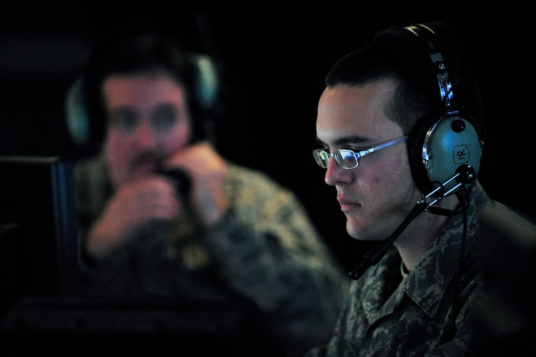 Senior Airman Daniel Shaub concentrates on a screen depicting Iraqi air space in the Control Response Center Jan. 29 at Joint Base Balad, Iraq. Members of the 727th Expeditionary Air Control Squadron are observing the sky and polling stations to give confidence to the Iraqi people and support them while they vote in the 2009 Iraqi provincial elections. Airman Shaub is a 727th EACS air surveillance technician deployed from the Kansas Air National Guard. (U.S. Air Force photo/Senior Airman Elizabeth Rissmiller)