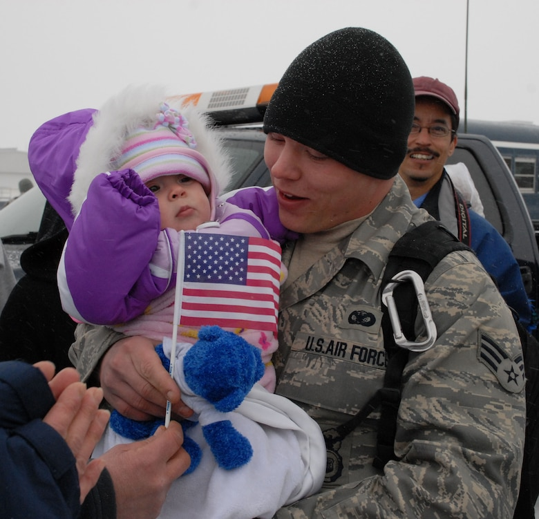 NIAGARA FALLS AIR RESERVE STATION, N.Y. - Family and friends greet Air Force Reserve Senior Airman Shane Williams as he returns home from a six month deployment to Iraq where the temperature upon arrival in the AOR was 120 degrees.  Williams and ten other members of the 914th Security Forces Squadron returned home to Western New York in January to below freezing temperatures and snow.  (U.S. Air Force photo by Mr. Michael Harvey)
