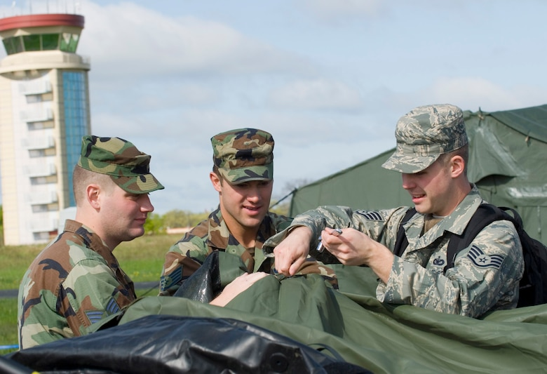 Minnesota Air National Guard Airmen of the 133rd Airlift Wing take apart a tent during a training exercise at Volk Field, Wis., May 14, 2009. Hundreds of men and women from the Minnesota Air National Guard joined Scott Air Force Base, Ill., Guardsmen for Exercise Readiness Safeguard at Volk Field, in preparation for an operational readiness inspection. (U.S. Air Force photo by Tech. Sgt. Erik Gudmundson/Released)