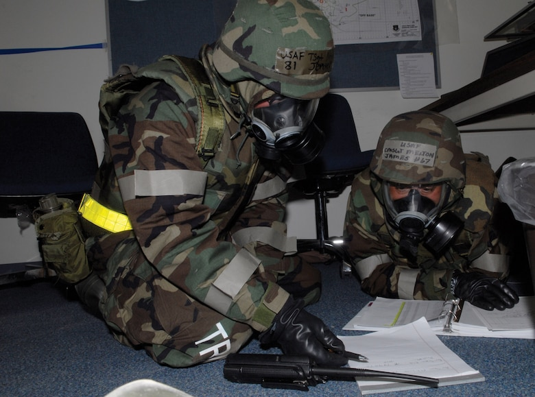 Tech. Sgt. Brian Jensen, 133rd Maintenance Squadron and Chief Master Sgt. James Melton, 133rd Aircraft Maintenance Squadron, assign members to Post Attack Reconnaissance (PAR) teams during Readiness Safeguard at Volk Field, Wis. on May 16, 2009.  Hundreds of men and women from the Minnesota Air National Guard unit joined others from Scott Air Force Base, Illinois for Readiness Safeguard in preparation for an Operational Readiness Inspection. USAF Official photo by Technical Sgt. Erik Gudmundson.(Released)