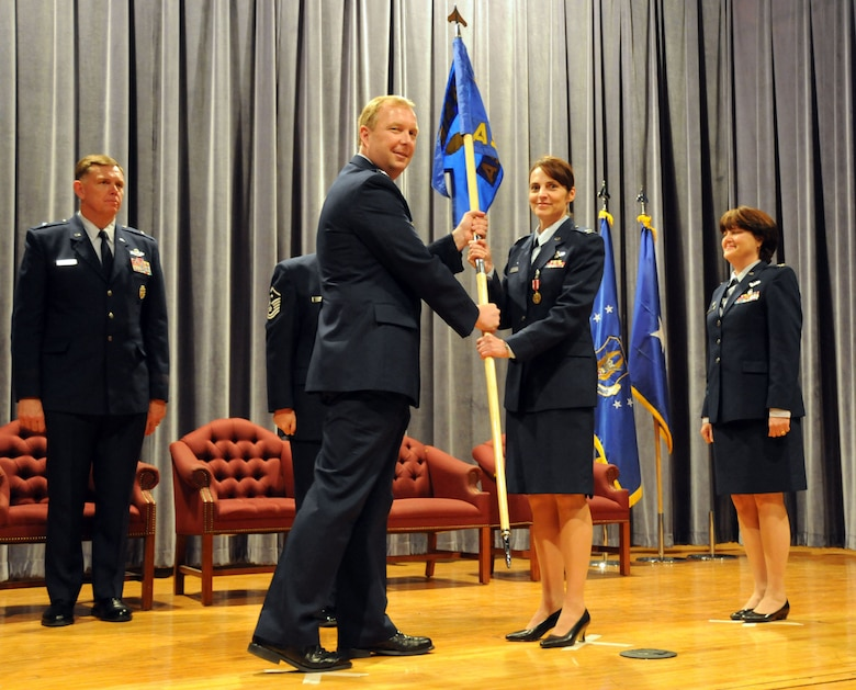 "NIAGARA FALLS AIR RESERVE STATION, N.Y. --  Col. Patricia A. Jarmuz (center) receives the 914th Aeromedical Staging Squadron (ASTS) guidon during a change of command ceremony at the James Roberts theater here May 2, 2009. Col. Jarmuz formally assumed command of the 914th ASTS from Col. Renata T. Sierzega (right), who commanded the unit for nine years. Former 914th Airlift Wing commander Brig. Gen. Wallace T. ""Wade"" Farris (left) presided over the ceremony, which included Col. Sierzega's retirement after more than 30 years of service.  (U.S. Air Force photo by Staff Sgt. Daniel Lanphear)"