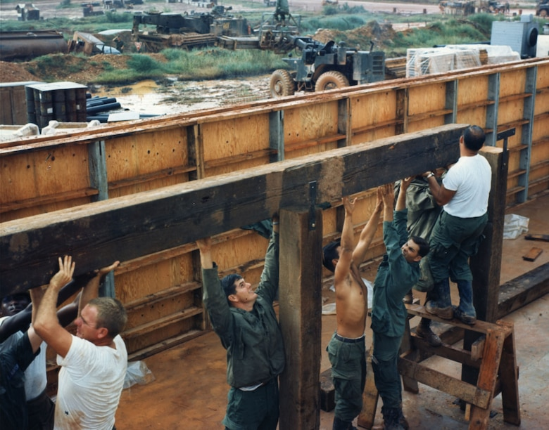 The 820th Civil Engineering Squadron, RED HORSE at Dong Ha, South Vietnam, erecting housing for USAF's Detachment 1, 620th Tactical Control Squadron in December 1967. The original housing was replaced by bunker quarters, because the base was frequently subjected to enemy artillery attacks. (U.S. Air Force photo)