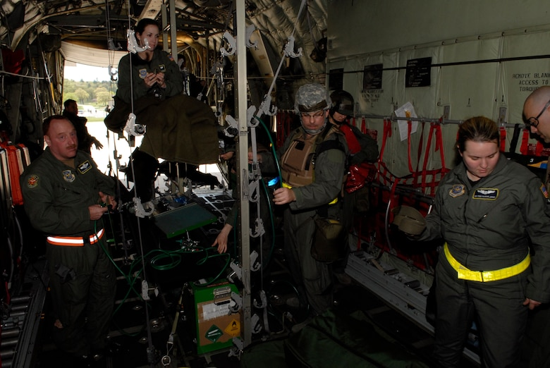 Within minutes, Airmen of the 109th Aeromedical Evacuation Squadron transformed the empty bay of a C-130 Hercules into a medical care facility capable of hauling wounded military members from the war zone to a hospital for treatment  during an exercise at Volk Field, Wis. on May 13, 2009. Hundreds of men and women from the Minnesota Air National Guard unit joined others from Scott Air Force Base, Illinois for Readiness Safeguard in preparation for an Operational Readiness Inspection. USAF Official photo by Technical Sgt. Erik Gudmundson.(Released)