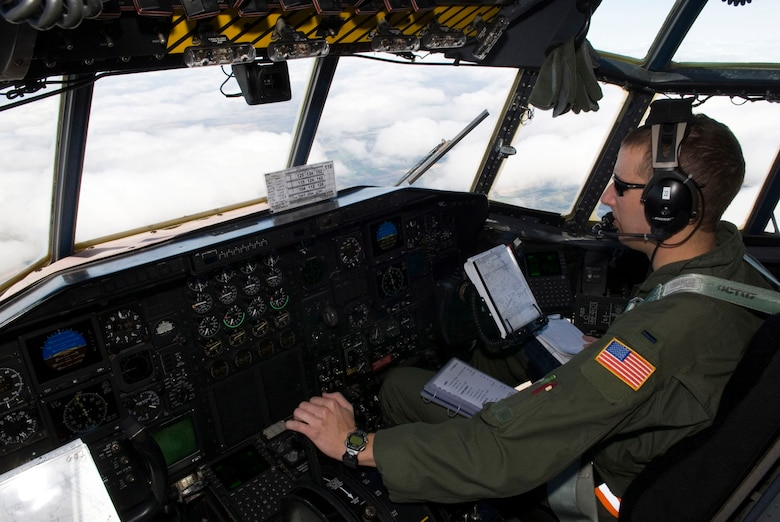 """A pilot with the 109th Airlfit Squadron, 133rd Airlift Wing, flies a C-130 """"Hercules"""" aircraft as part of a training mission at Volk Field, Wis. on May 16, 2009. Hundreds of men and women from the Minnesota Air National Guard unit joined others from Scott Air Force Base, Illinois for Readiness Safeguard in preparation for an Operational Readiness Inspection. USAF Official photo by Technical Sgt. Erik Gudmundson.(Released)"""