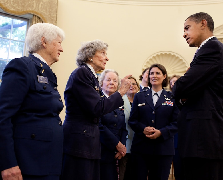 President Barack Obama chats with WASP pilots Elaine Harmon (left) and Lorraine Rodgers in the Oval Office after signing S.614, a bill to award a Congressional Gold Medal to Women Airforce Service Pilots July 1 at the White House. The WASP program was established during World War II, and from 1942 to 1943, more than 1,000 women joined, flying 60 million miles of noncombat military missions. Of the women who received their wings as Women Airforce Service Pilots, approximately 300 are living today. (Official White House photo/Pete Souza)