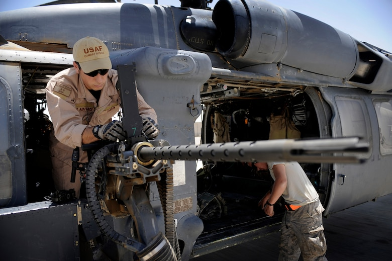 Senior Airman Adrian Jarrin conducts a preflight inspection of a .50 caliber machine gun June 25 at Camp Bastion, Afghanistan. Airman Jarrin is an aerial gunner with the 129th Expeditionary Rescue Squadron. (U.S. Air Force photo/Staff Sgt. Shawn Weismiller)