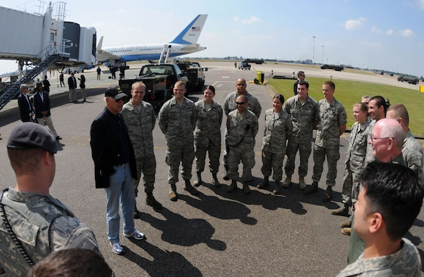 Standing on the RAF Mildenhall flight line July 2, Vice President Joe Biden talks with a group of Airmen, thanking them for their service and encouraging them to continue doing a great job.  The Vice President stopped at the base for a few hours en route to an unspecified location. (U.S. Air Force photo by Staff Sgt. Austin M. May)