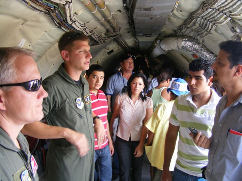 Capt. Isaiah Oppelaar, a pilot deployed here from MacDill Air Force Base, Fla., gives a tour of the KC-135 June 21 during an air show. More than 30 Airmen participated at the international air show June 20-21. The more than $35,000 proceeds from the show will help build a children?s intensive care unit at a local hospital.
