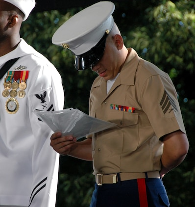 Sgt. Nilton Arrubla Torres, 1st Marine Corps Recruiting District, administrative clerk, along with six other service members, views his citizenship paperwork after completing their Oath of Citizenship during a ceremony on Liberty Island before the reopening of the Statue of Liberty's crown. The crown had been closed since the terrorist attacks of 9/11. (Official Marine Corps photo by Sgt. Randall A. Clinton)