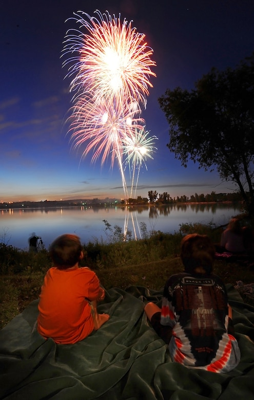 OFFUTT AIR FORCE BASE Neb. -- Two children watch the night skies over the base lake explode with colors as they attended the Independence Day celebration July 2. The annual celebration, included games, refreshments and a fireworks display at dusk.