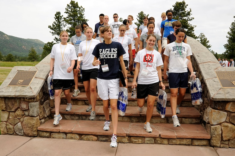 Basic cadets take their first steps into their Air Force careers as they leave Doolittle Hall and cross over the Memorial Bridge during cadet inprocessing June 25 at the U.S. Air Force Academy in Colorado Springs, Colo. (U.S. Air Force photo/Mike Kaplan)
