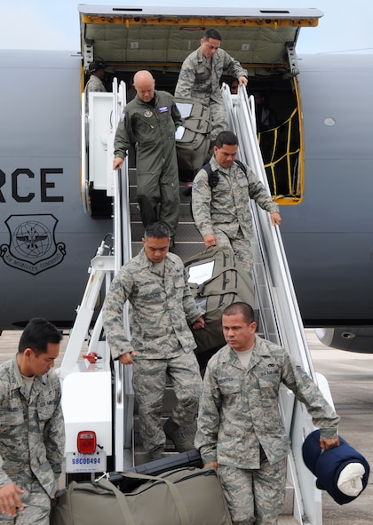 Airmen from the 506th Expeditionary Air Refueling Squadron remove belongings from a KC-135 Stratotanker after it lands at Andersen Air Force Base, Guam.  The KC-135 returned from a deployment to Alaska after an exercise, Northern Edge 2009, to practice mission planning and procedures.  The KC-135s are deployed here to support of the U.S. Pacific Command's Theater Security Package in the Asia-Pacific Region. (U.S. Air Force photo/ Senior Airman Christopher Bush)
