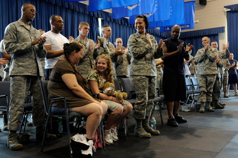 Bailey Reese, founder and president of the non-profit organization, Hero Hugs, and her mother, Diana, receive a standing ovation from members of both the United States Air Force Honor Guard and the 11th Wing after being introduced at the Drill Team's evaluations July 7 on Bolling Air Force Base, D.C. Bailey first met the Drill Team at Dobbins Air Reserve Base, Ga., during one of the team's performances and was invited to visit the Drill team back in D.C. (U.S. Air Force photo by Staff Sgt. Dan DeCook)